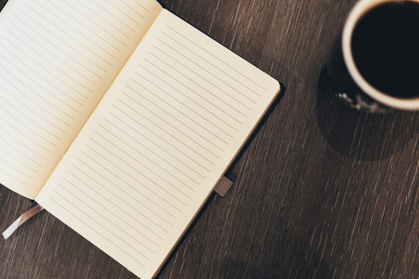 blank journal page and a coffee mug