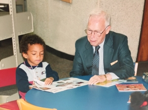 John Germany reading with a child